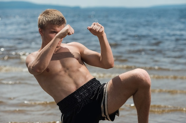 Muscular male fighter training