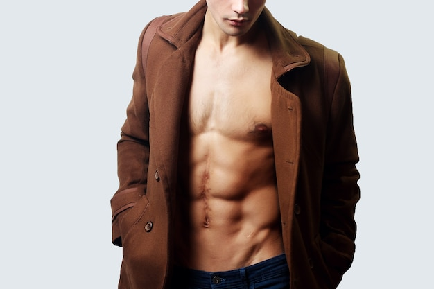 Muscular male wearing a jacket without shirt