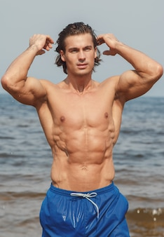 Muscular man on the beach