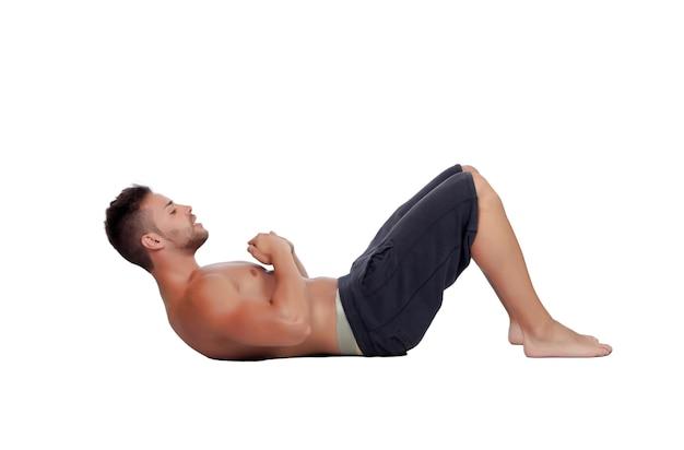 Muscular man doing abdominals