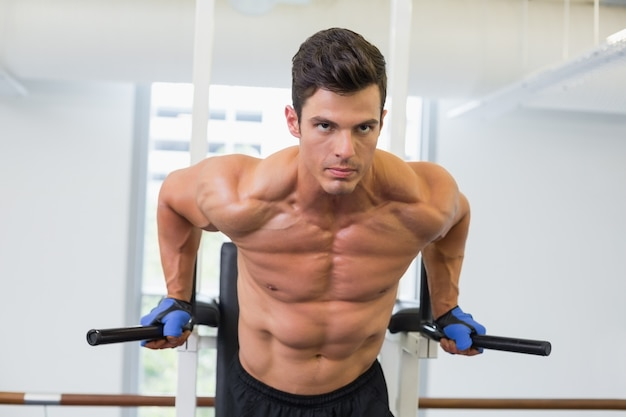 Muscular man doing crossfit fitness workout