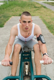 Muscular man during his workout outdoors