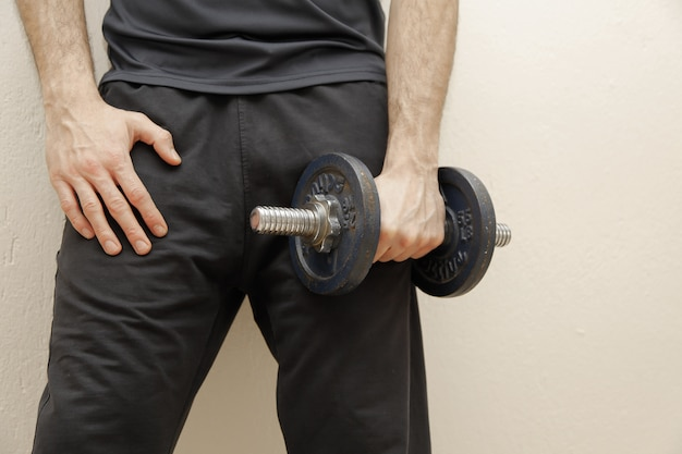 Muscular man is holding dumbbell. sport concept.