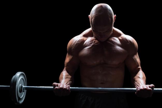 Muscular man lifting