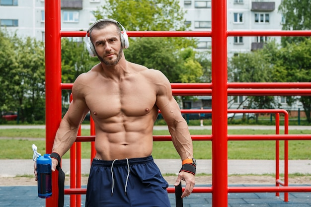 Muscular man listening music