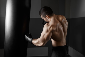 Muscular man practicing boxing