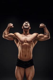 Muscular man screaming