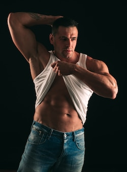 Muscular man showing abs six packs male striptease mans bare torso handsome guy posing sporty health...