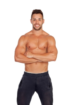 Muscular man showing his body isolated on white background