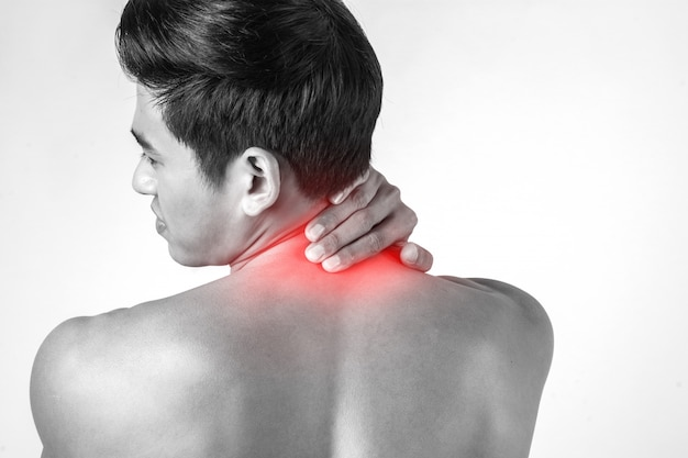 Muscular man use handles at the neck to relieve pain isolated on white background.