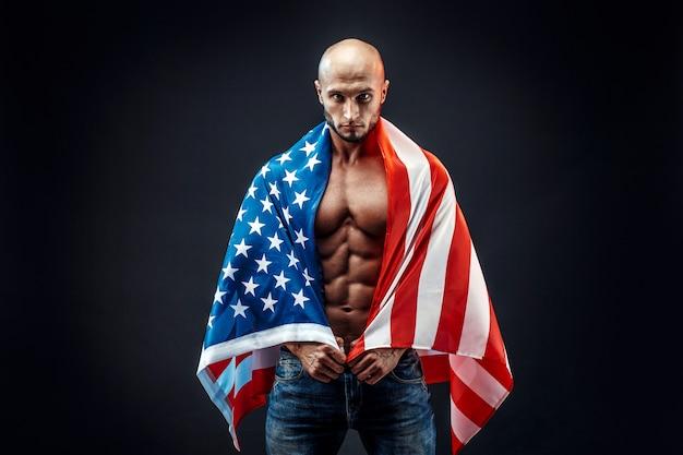 Muscular man wearing american flag