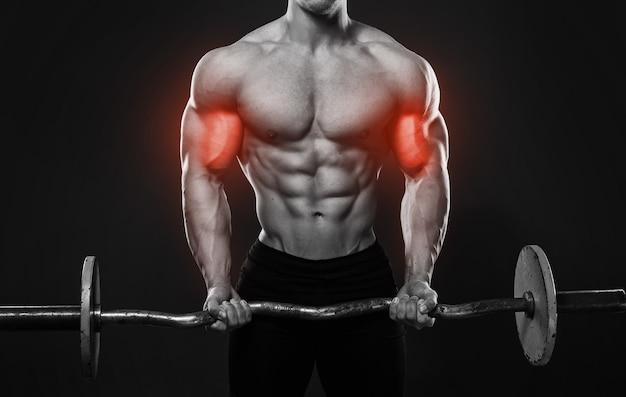 Muscular man working out with a barbell. specialization for biceps in bodybuilding.