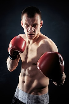Muscular muay thai fighter looking at