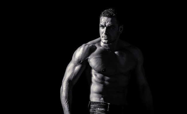 Muscular sexy man with torso. muscular model sports young man on dark background. sensual man with naked strong ab. muscular torso close up. torso concept. fashion portrait of strong brutal guy