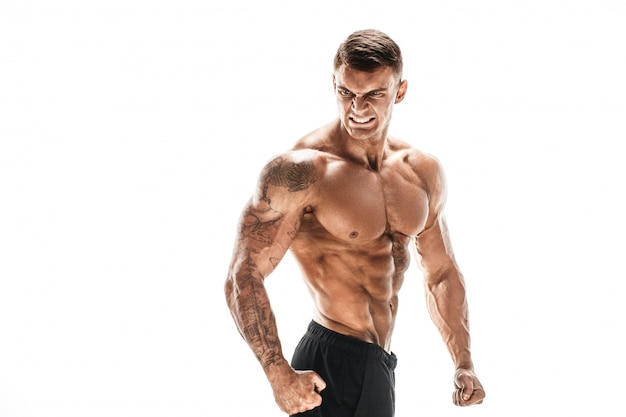 Muscular super high level handsome man posing on white backgroun