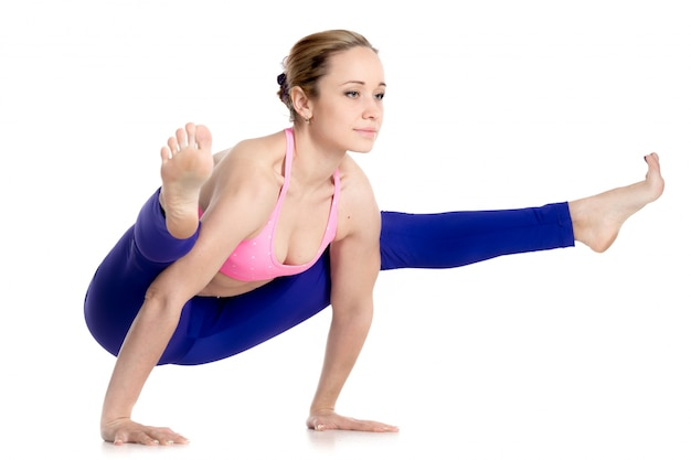 Muscular woman with advanced yoga pose