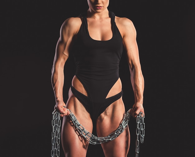 Muscular woman with iron chain