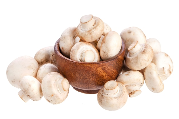 Mushroom champignon in wooden bowl