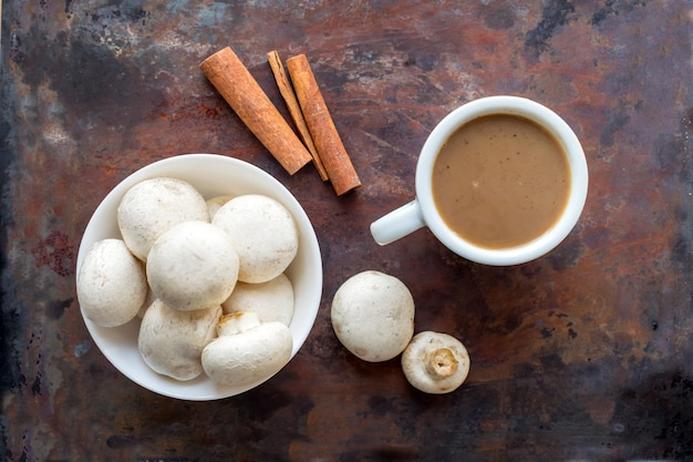 Mushroom coffee superfood trend. cup of coffee and white bowl with mushrooms