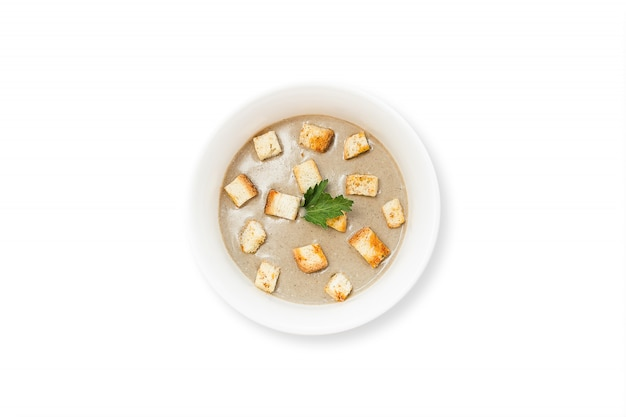 Mushroom cream soup with champignons, cream, onion, garlic isolated on white background.