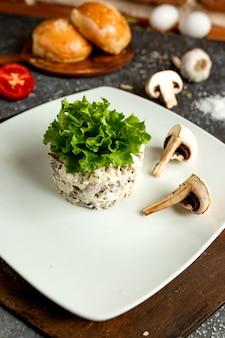 Mushroom salad seasoned with mayonnaise on a white plate