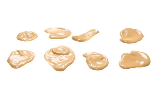 Mushroom sauce splashes isolated on white background. top view.