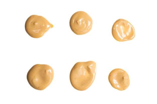 Mushroom sauce splashes isolated on white surface. top view.