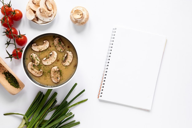 Mushroom soup and empty notepad