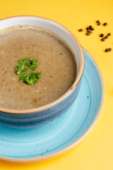 Mushroom soup with pepper and herbs