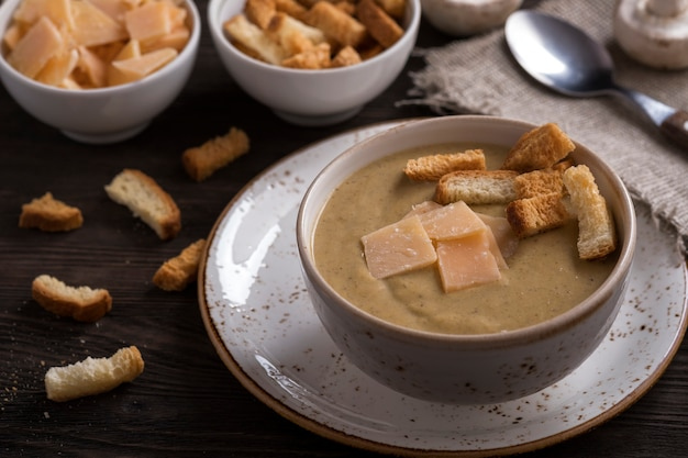 Mushroom soup with toasts and cheese. vegetarian soup