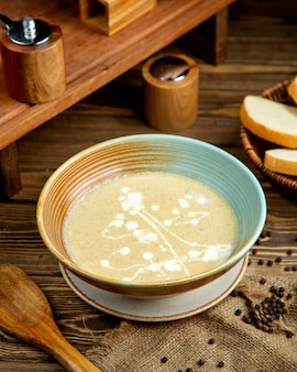 Mushroom soup with white bread slices