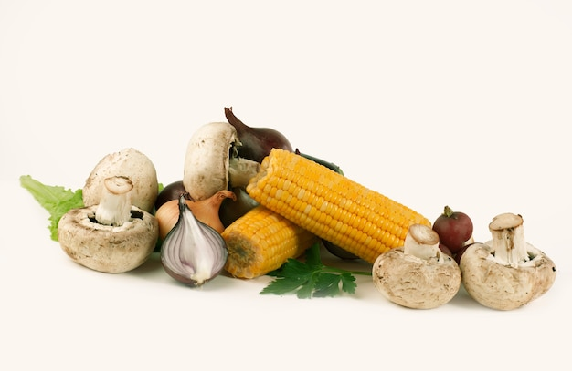 Mushrooms and fresh vegetables.isolated on a white background.photo with copy space