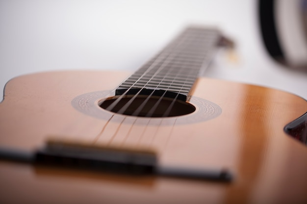 Music background, guitar fretboard out of focus on light background