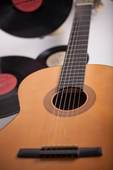 Music background, guitar and old vinyl records