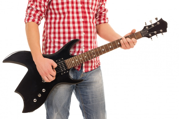 Music, close-up. musician holding electro guitar