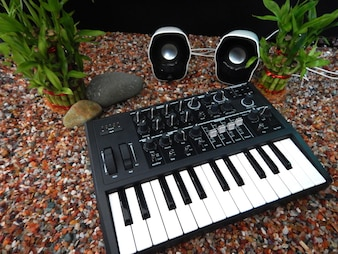 Music controller foreground, Electronic musical instrument or audio mixer or sound equalizer (analog modular synthesizer)