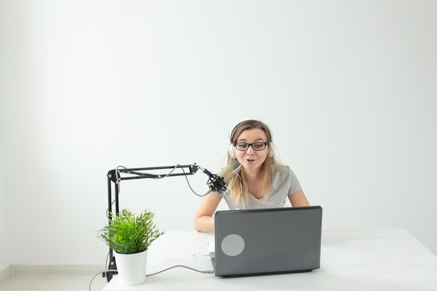 Music dj blogging and broadcasting concept  female radio host with a funny expression