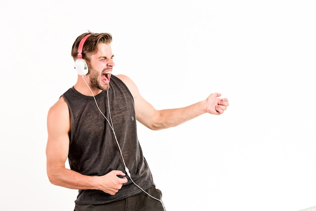 Music drives him dance. equipment for dj. start this party. man handsome dj using modern headphones. professional musical software and devices. cheerful dj full of energy. entertainment concept.