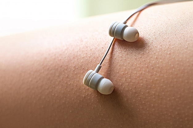 Music lover is having goosebumps and enjoying from favorite relaxing song.