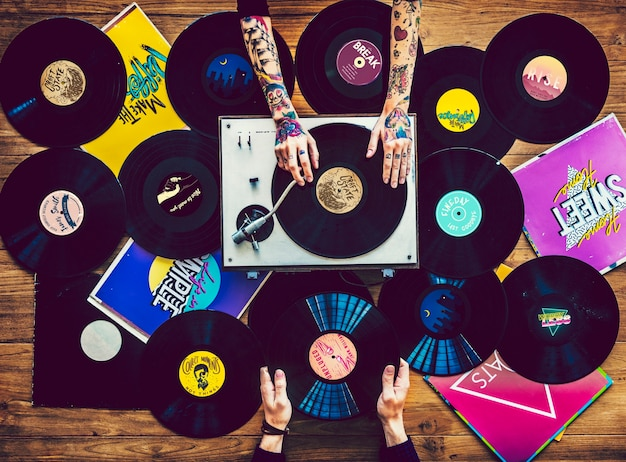 Music lovers with vinyl records collection