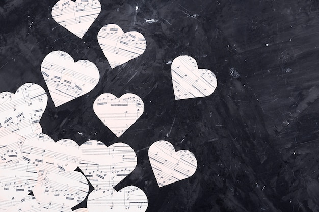 Music notes on heart shaped paper