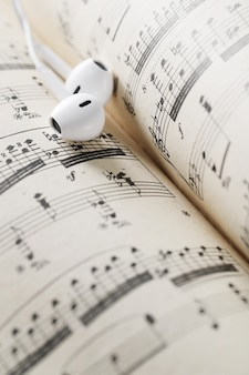 Music notes sheet and earphones