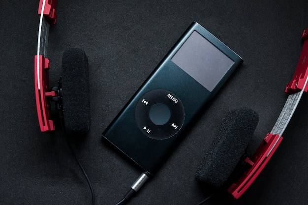 Music player audio portable with red headphones