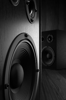 Music stereo speakers in black on a dark background. 3d rendering