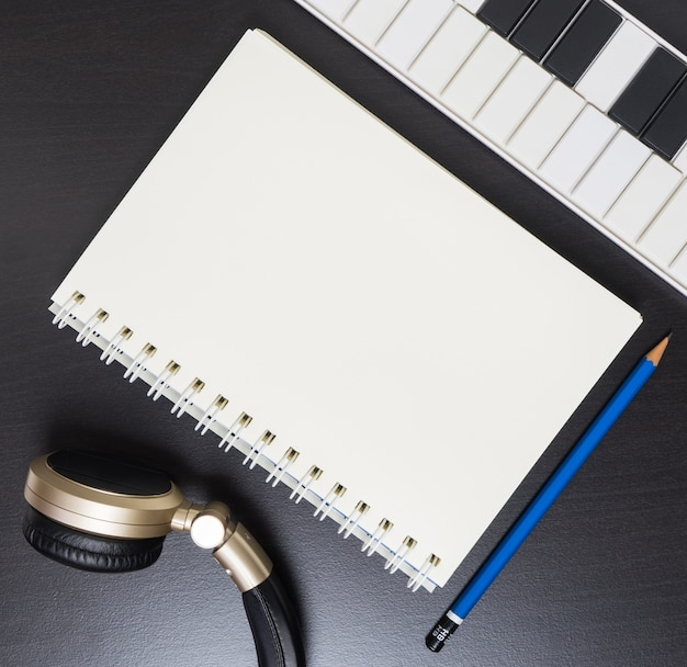 Music writing equipment. blank book page for music copy space.