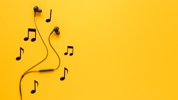 Musical notes and earphones with copy space