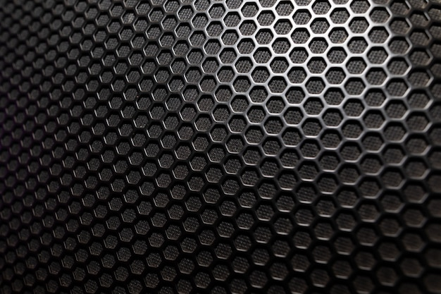 Musical powerful speaker with a protective grill close-up