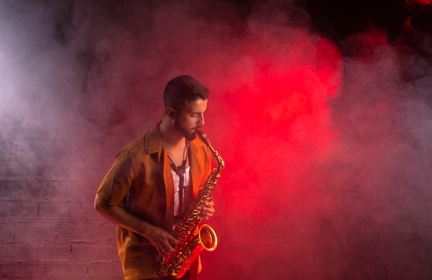 Musician in fog playing the saxophone