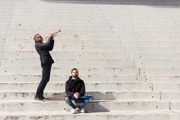 Musician friends in a stadium