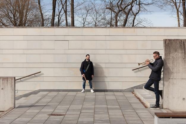Musician friends in urban environment